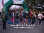 Runners stream through the starting line chute at the Seabrook Marathon