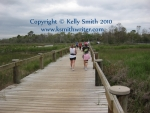 Crossing a bridge in Seabrook's Pine Gully Park
