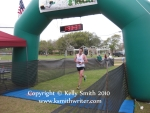 Crossing the finish line at the Lucky Trail Half Marathon